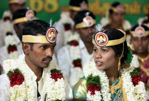 Coimbatore: Couples at a mass marriage ceremony organised to mark the AIADMK leader and Tamil Nadu Chief Minister J Jayalalithaa's 68th birthday at Udumalpet in Coimbatore on Friday. PTI Photo (PTI2_5_2016_000112B)